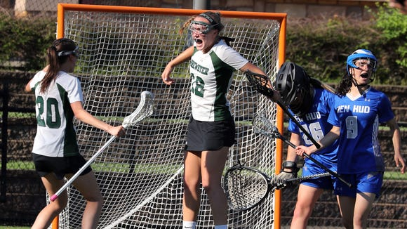 Brewster's Meagan Beal, 12, celebrates her first half goal during the Section 1 Class C girls lacrosse championship against Hendrick Hudson at the Torne Valley Athletic Center in Hillburn May 24, 2018.