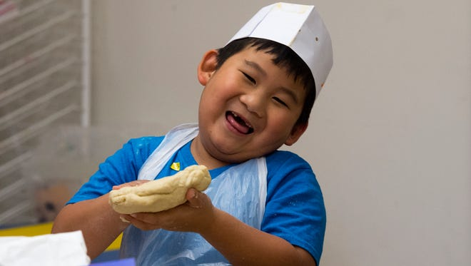 Children at Camp Gan Israel summer camp at Pinewood Elementary School in Stuart last year learned how to cook.