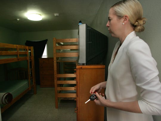 Salvation Army program director Sandra Troxell shows one of the rooms for a family of four at the transitional living center in Ventura. The Salvation Army lost federal grants that paid for transitional living.