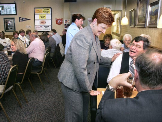 Former Franklin Mayor Brenda Jones-Matthews talked with Johnson County Magistrate Richard Tandy and Superior Court Judge Kevin Barton, as she worked the crowd at Don and Dona's restaurant in Franklin during the monthly Johnson County Republicans luncheon on Nov. 2, 2005.