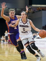 Missouri State's Liza Fruendt drives against Evansville's Kerri Glasper