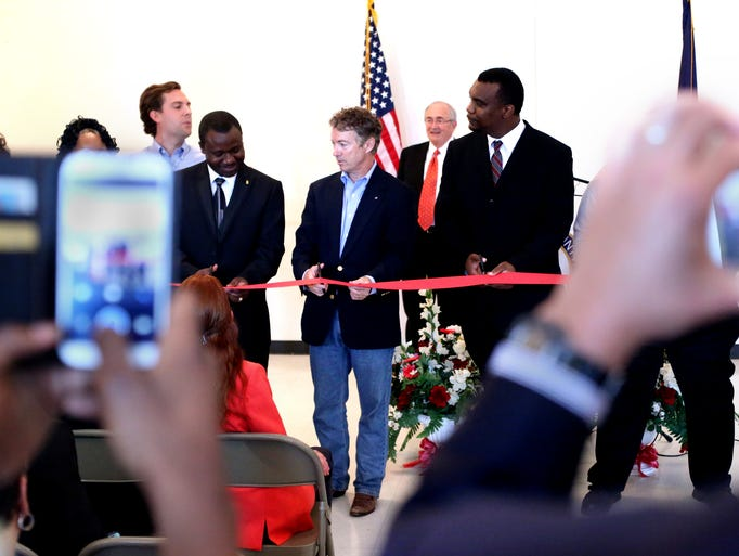 Senator Rand Paul, center, and others cut a ribbon during the grand opening of the Jefferson County Republican Party's west end headquarters at the Trinity Life Center. June 7, 2014