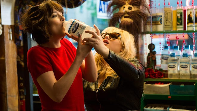 "Robin (Rebel Wilson, right) helps Alice (Dakota Johnson with hangover tips in ""How to Be Single."""