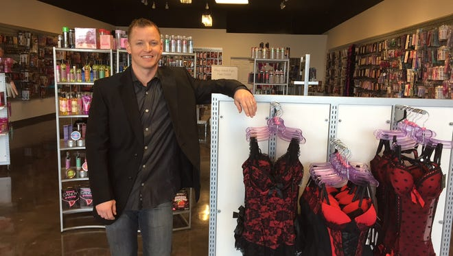 Dustin Flynt, owner of the new Jimmy Flynt's Sexy Gifts in Sharonville, says critics attempting to remove his giant billboard ad on I-71 and close his store are infringing on his free expression and rights as a business owner.