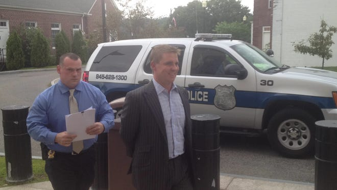 Carmel Detective Michael Russo escorts George Galgano into Putnam County Court on Aug. 21.