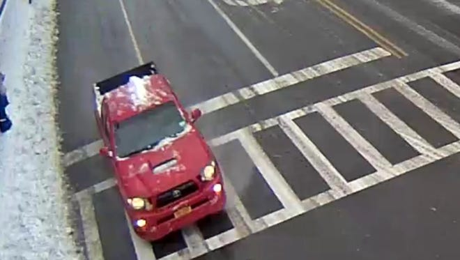 The driver of this pickup truck ran over a man in New Rochelle on Saturday and fled the scene, leaving the victim in critical condition, police said.