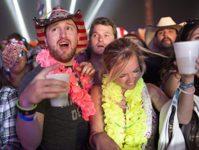 Festival-goers dance to DJ KO inside the Electric Thunder