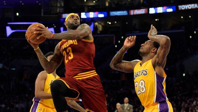 LeBron James looks to shoot against Lakers forward Tarik Black.