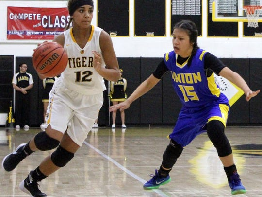 Allyssa Madden, left, drives past Casa Grande's Anisa Monteau. Alamogordo defeated Casa Grande 66-37 in the Back in Action Therapy Holiday Tournament to capture second place.