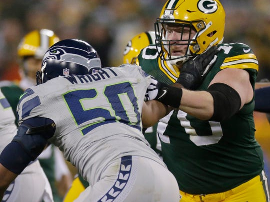 Green Bay Packers guard T.J. Lang (70) blocks Seattle Seahawks outside linebacker K.J. Wright (50) during the fourth quarter of their game Sunday, December 11, 2016 at Lambeau Field.