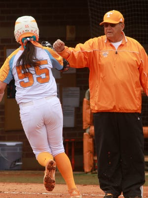 Tennessee coach Ralph Weekly congratulates Meghan Gregg at third base during a game in March.