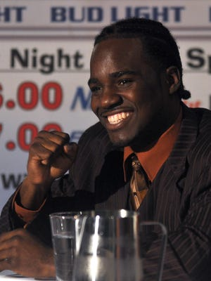 Fernando Guerrero pumps a fist during a 2010 news conference at Brew River in Salisbury.