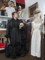 Kate Butler wears an 1880s Victorian mourning costume she uses to portray Lizzie Borden. 'When I'm in that dress, I become Lizzie,' says Butler. 'I'd pass out in the middle of the performance.'