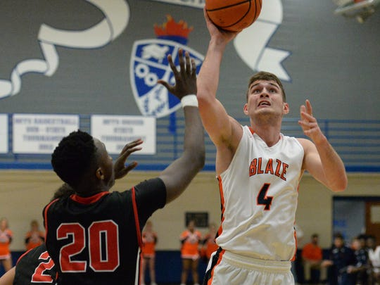 Blackman's Christian Dewitt goes up for a shot in the Blaze's win over Stewarts Creek on Saturday in the District 7-AAA tournament at La Vergne.