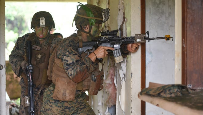 U.S. Marines conduct a demonstration of an assault to gain control of an abandoned building at Andersen South in Yigo on Monday, Nov. 7, 2016. The Makin Island Amphibious Ready Group and 11th Marine Expeditionary Unit, from San Diego and Camp Pendleton, California, are participating in Exercise Keen Sword 17, according to a Joint Region Marianas release.