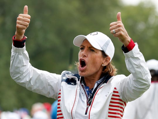 FILE - In this Aug. 19, 2017, file photo, United States captain Juli Inkster gestures to the gallery during a foursomes match in the Solheim Cup golf tournament, Saturday, Aug. 19, 2017, in West Des Moines, Iowa. Inkster is the first American to be Solheim Cup captain three times. Now she'd like the distinction of being the first American captain with three victories. (AP Photo/Charlie Neibergall, File)