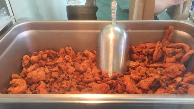 Frexh cracklins are kept in a heat box at T-Red's Cajun Cuisine in Dubach.