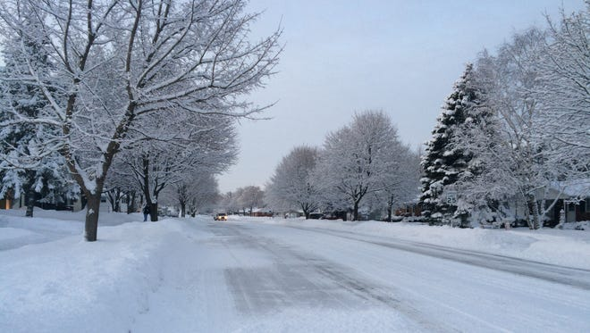 A freshly plowed street on Green Bay's west side. About 4 inches of snow fell overnight.