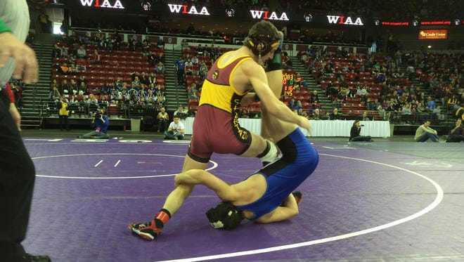 Luxemburg-Casco's Eric Peters (top) takes on Evansville/Albany's Jordan Meyer on Friday in a WIAA Division 2 state quarterfinal match at 145 pounds. Peters won the match 3-1.