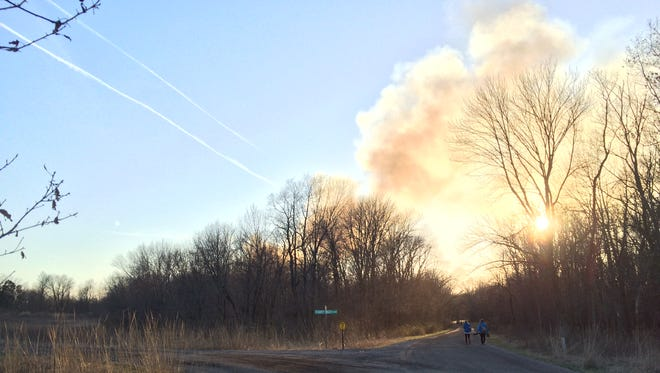 Smoke is seen from a house fire on Starry Night Lane on the outskirts of Solon on Monday, March 28, 2016.