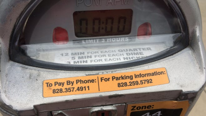 All city of Asheville parking meters still accept coins.
