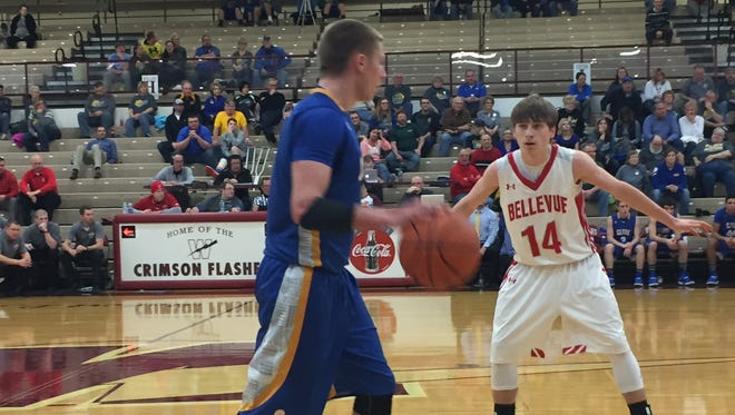 Bellevue's Trey Ruhlman, here guarding Clyde's Conner Long in a February contest, scored 27 points against Sandusky on Friday.
