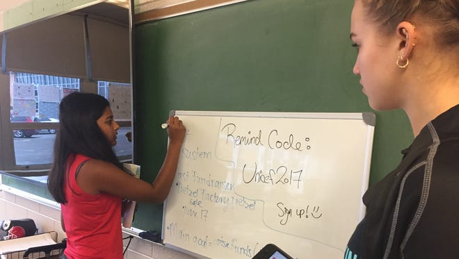 Priya Patel, (left) is launching a student-group at Vineland High School to raise money to support UNICEF's work with children worldwide. More than 20 students attended the first meeting Wednesday including Angelina Bartolozzi (right)