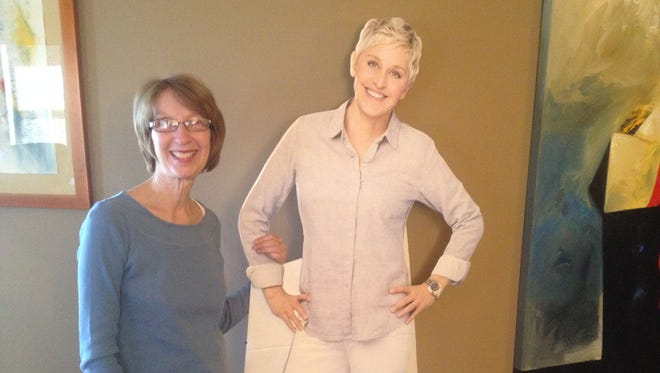 Pamela Shilling of Phoenix with a cardboard cutout of the star of her favorite show. She just won tickets to attend Ellen's 12 Days of Giveaways event.