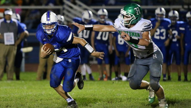 Southeastern's Lane Ruby evades a defender last week against Huntington in a 56-14 win. The undefeated Panthers travel to Piketon in Week 5.