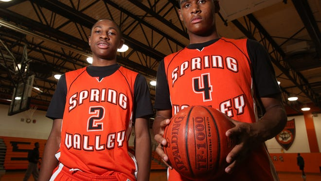 Spring Valley basketball players Rickey McGill, left, and Kai Mitchell.