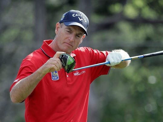 Jim Furyk checks his driver on the second tee during round-robin play at the Dell Technologies Match Play golf tournament at Austin County Club, Thursday, March 23, 2017, in Austin, Texas. (AP Photo/Eric Gay)