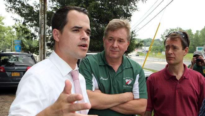 State Sen. David Carlucci gestures as he talks about funding for a bike path to connect the two parts of Greenbush Road in Blauvelt, allowing cyclists to avoid the heavily trafficked Route 303.Looking on are Orangetown town Councilman Paul Valentine and town Supervisor Andy Stewart.