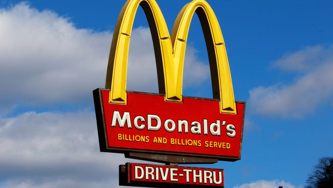 This is the McDonald's sign outside a restaurant in downtown Pittsburgh. A craving for a McDonald's cheeseburger apparently prompted an 8-year-old Ohio boy to take his 4-year-old sister for a ride in his dad's van, which he learned to drive on the internet.