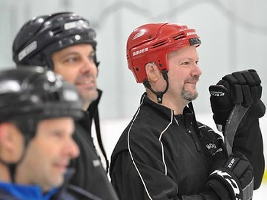 The first-annual 'Father-Son' weekend gave dads of Plymouth hockey players a chance to relax and have fun on the ice. From left are Tim Gallaher, Joel Roach and Joel Gavin.