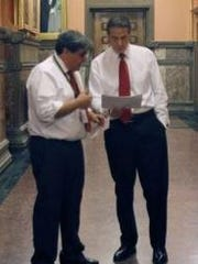 A photo of Drew Zambelli and Gov. Andrew Cuomo in the hall of the state Capitol.