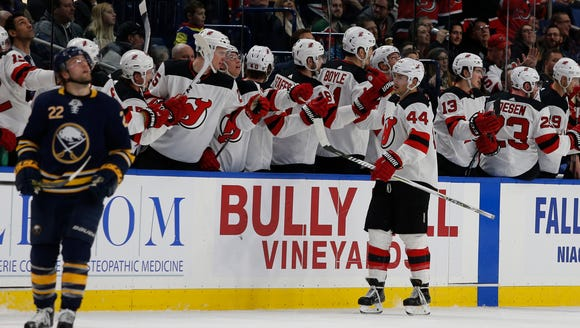 New Jersey Devils left wing Miles Wood (44) celebrates