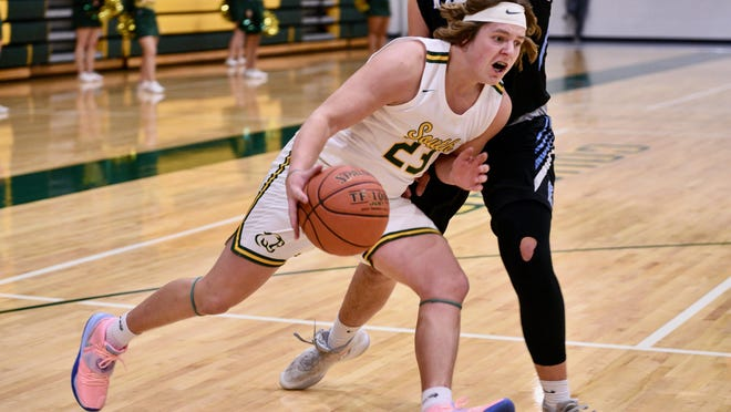 Salina South senior Kade Barber (23) drives to the basket against Goddard Eisenhower during Friday's game at the South gym.