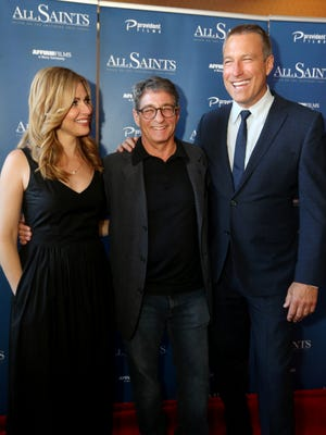 """Actor Cara Buono, left, Director Steve Gomer, and Actor John Corbett have their picture taken together at the  red carpet event and VIP screening of their locally filmed movie""""All Saints"""" was held at the Malco Roxy Theater in Smyrna, a on Thursday, Aug. 3 2017."""