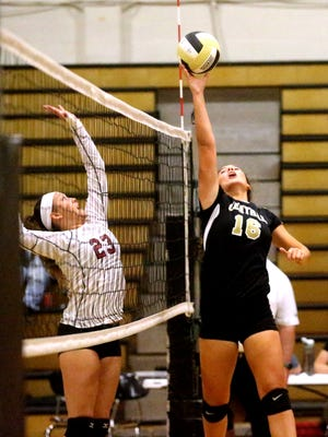 Central Magnet's Mary Catherine Smith (16) goes high during a recent match. Smith and the Lady Tigers earned a region berth Thursday.