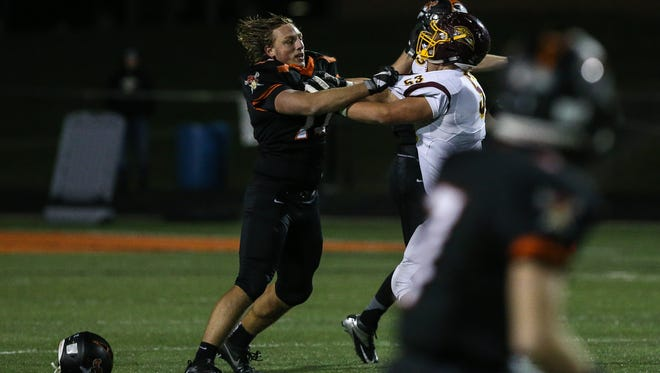 Ryle offensive lineman Parker Bisek loses his helmet as he blocks Cooper's Sander Roksvag during the first quarter of their 6A playoff game at Ryle, Friday, November 11, 2016.