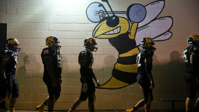 The Menard Yellow Jackets walk past their locker room at halftime of a game in 2014. Menard hosts Rocksprings on Friday, Sept. 14, 2017 in the Standard-Times Game of the Week.