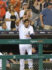 Tigers third baseman Jeimer Candelario celebrates the go-ahead run scoring during the eighth inning of the Tigers' 5-2 win over the Twins on Wednesday, June 13, 2018, at Comerica Park.