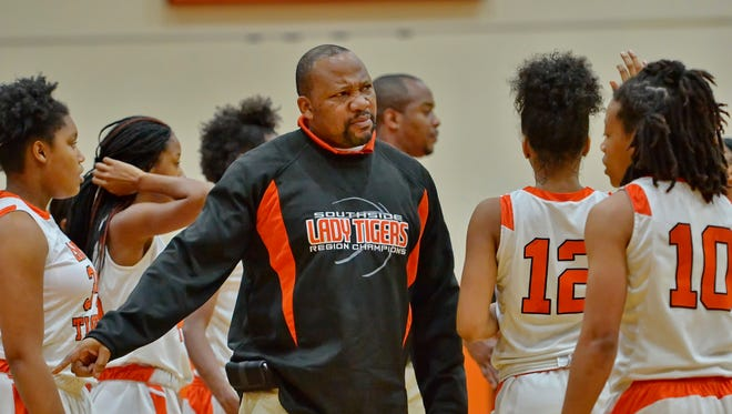 Southside High School girls basketball coach Lamont Wakefield recently collected his 200th win, but victories off the court are what drive Wakefield, who in his 11th season as the Tigers' leader.