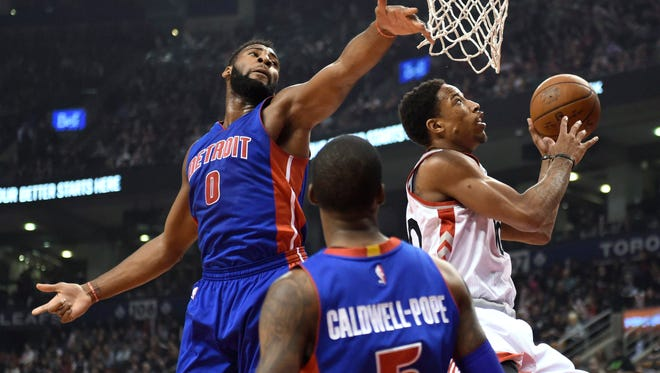 Raptors guard DeMar DeRozan (10) drives to the basket as Pistons center Andre Drummond (0) defends during the first half Saturday in Toronto.