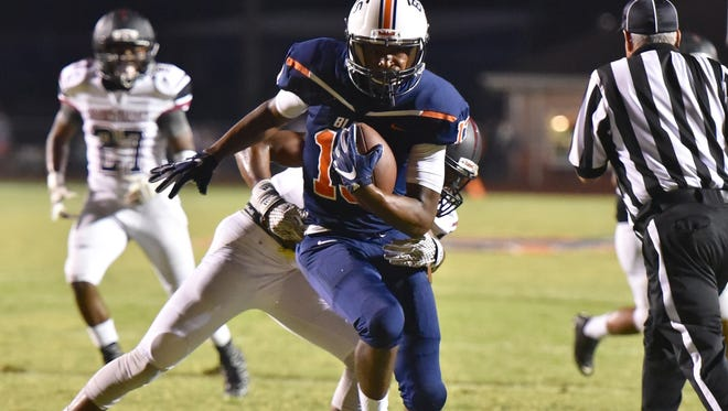 Blackman's Trey Knox eludes a Shades Valley defender during the Blaze's contest Friday night.