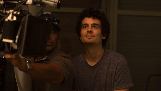 "Director Damien Chazelle on the set of ""La La Land."""