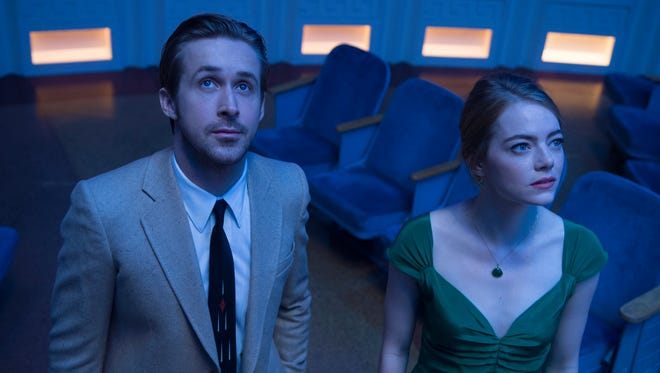 """This image released by Lionsgate shows Ryan Gosling, left, and Emma Stone in a scene from, """"La La Land."""" The film was nominated for a Golden Globe award for best motion picture musical or comedy on Monday, Dec. 12, 2016. The 74th Golden Globe Awards ceremony will be broadcast on Jan. 8, on NBC."""