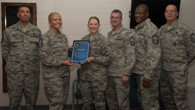 Airmen 1st Class Allison S. Block, a 49th Force Support Squadron career development apprentice, receives the March Chief's Choice Award, from Chief Master Sergeant Sarah Esparza, the 49th FSS superintendent, April 10, 2017, at Holloman Air Force Base.