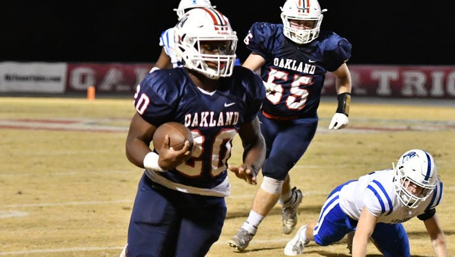 Oakland's Cameron Snelling heads downfield during Friday's 42-6 win over Lebanon in the first round of the Class 6A state football playoffs.