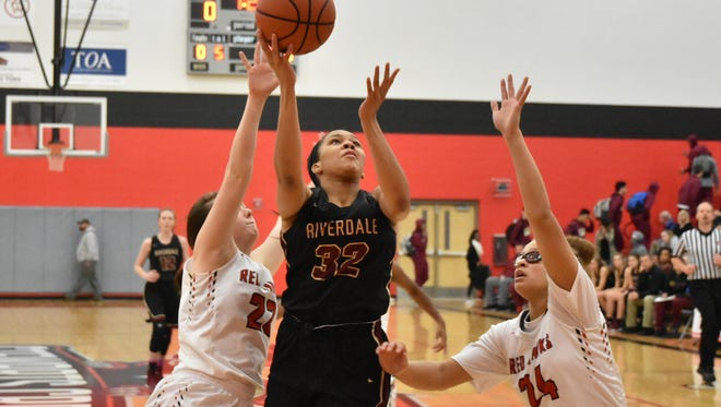 Riverdale's Brinae Alexander (32) goes up for two of her 16 points during Friday's game at Stewarts Creek.